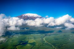 Aerial image of mount kilimanjaro, africa's highest mountain, with snow and w Stock Photos