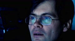 Adult man in front of computer in dark room Stock Footage