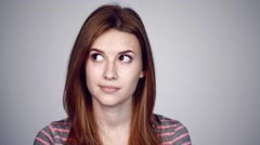Thinking woman looking in different directions - stock footage