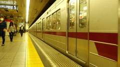 Subway Train Exits the Station at Japan Metro Rail Station - Tokyo Japan Stock Footage