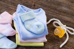 newborn baby clothes - stock photo
