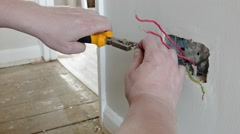 Electrician: preparing the wires for a UK plug wall socket - stock footage