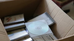 Throwing old cd cases - stock footage