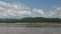 Longtail boat at the mekong river landscape, Laos Stock Footage