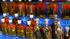 Local alcohol bottles with snakes and scorpions in it at Luang Prabang, Laos Stock Footage