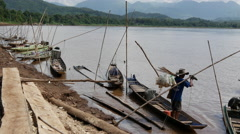 Fisherman get ready to fish at the mekong river landscape, Laos Stock Footage
