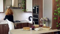 Woman cleaning kitchen Stock Footage