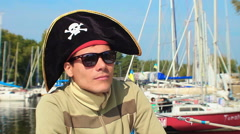 Young guy wearing silly cocked pirate hat, outdoor activities, click for HD Stock Footage