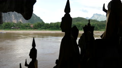 Silhouette from buddha statues in the Pak Ou Caves, Laos Stock Footage