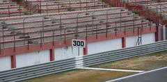 300 limit signal and empy grandstand - stock photo