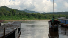 Longtail boat leaving the Pak Ou Caves, Laos Stock Footage