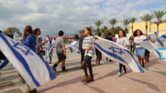 Israeli youth group dance with Israeli flags Stock Footage
