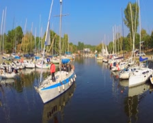 Sailboat with tourists sailing away, yachts and boats in harbor, click for HD Stock Footage