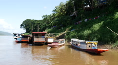 Long-tail boats at the shore in Luang Prabang, Laos Stock Footage