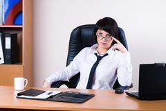 Pretty business lady with laptop - stock photo