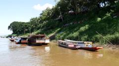 Long-tail boats at the shore in Luang Prabang, Laos Stock Footage