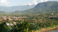 Pan from Mount Phou Si and city view of Luang Prabang Stock Footage