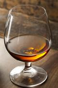 Amber brandy in a glass Stock Photos