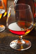 amber brandy in a glass - stock photo