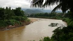 Nam Khan river in Luang Prabang, Laos Stock Footage
