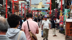 Tourists at Shopping Stalls Outside Sensoji Temple  -  Tokyo Japan Stock Footage