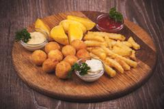 fried potato platter with dips - stock photo