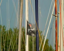 Stock Video Footage of Black pirate flag on the wind, skull and crossbones, yachting, click for HD