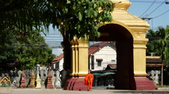 Monk walking at Wat That in Luang Prabang, Laos Stock Footage