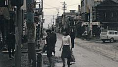 Japan 1964: pedestrians walking in the street - stock footage