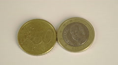 Stock Video Footage of two euro coins the back of a 50 spain cent and front detail