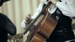 Two cellist playing fingers on cello at the concert Stock Footage