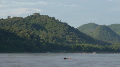 Fisherman at the mekong river in Luang Prabang, Laos Stock Footage