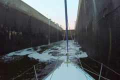 Canal lock filling with dirty water. Boats, transport, industry, click for HD Stock Footage