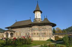 church in a .nunnery  sucevita decorated with frescoes, romania - stock photo