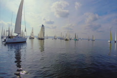 Marine landscape, silhouettes of yachts in the sea, white sails, click for HD Stock Footage