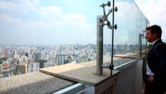 People at the top of a building looking to the huge city of Sao Paulo, Brazil. Stock Footage