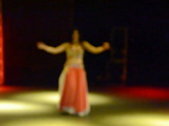 The dancer on a scene out of focus Stock Footage