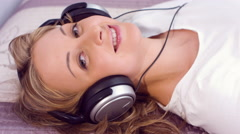 Pretty young woman listening and feel music Stock Footage