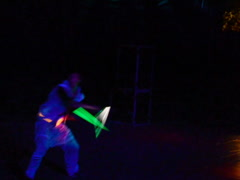 Juggling by neon light. Related clips are in my portfolio in 1920x1080. Stock Footage