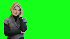Caucasian young woman talking on the mobile phone over green screen, chromakey Stock Footage