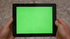 MAN HOLDS TABLET COMPUTER WITH GREEN SCREEN 4K - stock footage