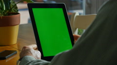 4K MAN WITH TABLET COMPUTER WITH GREEN SCREEN - stock footage