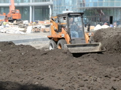 Earthwork in the summer on building - stock footage