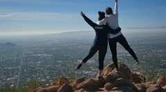 GIRLS POSE ON MOUNTAINTOP - stock footage