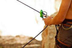 Belayer with the rope and carabines Stock Photos
