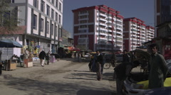 People crossing the street in Kabul Stock Footage