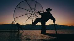 Two Burmese Fisherman on Inle Lake at Dawn Stock Footage