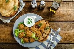 Health crunchy falafel with mint and garlic dip, naan bread with cumin and he Stock Photos
