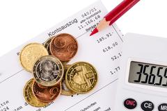Account statement and coins Stock Photos