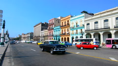 Havana Cuba old classic cars and taxis on street at Capital in downtown city of Stock Footage